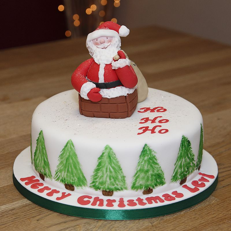 Christmas Cake Ideas Santa : Christmas Cake with handmade fondant Santa climbing down a ...